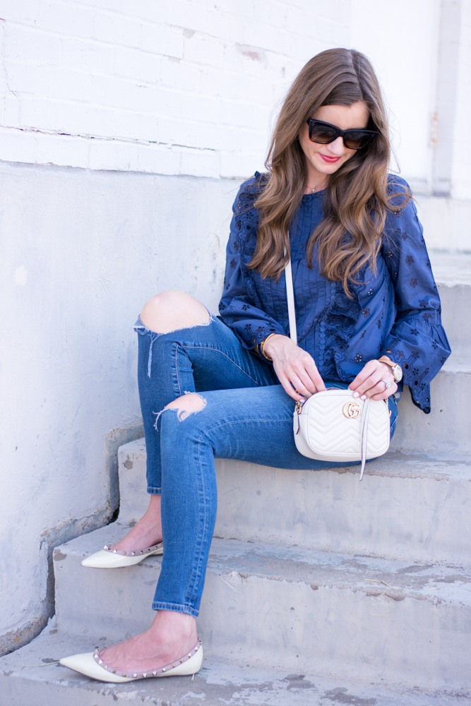 navy blue lace top distressed jeans white gucci crossbody bag