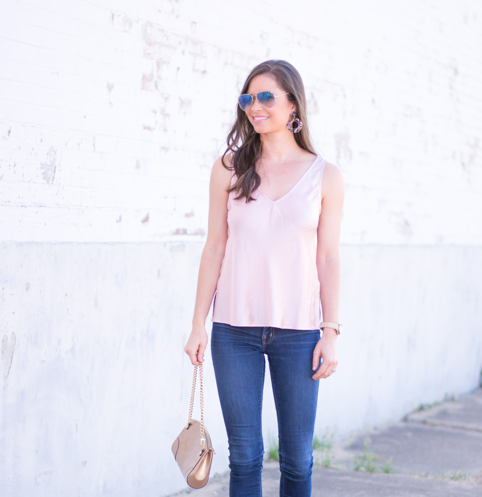 weeknight date night look blush pink silk top jeans gold clutch