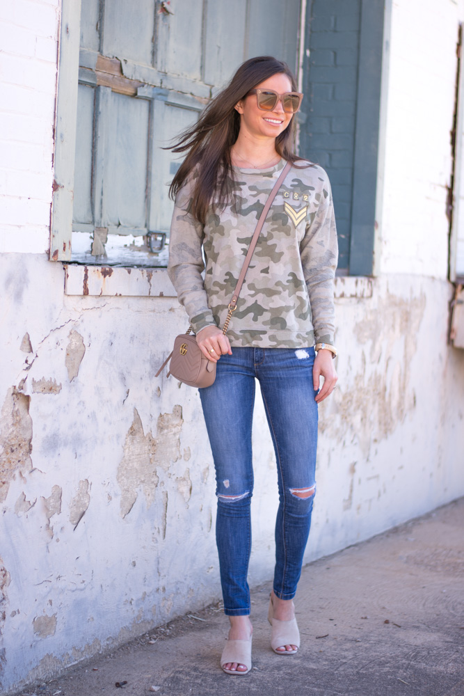 camo sweatshirt, distressed jeans