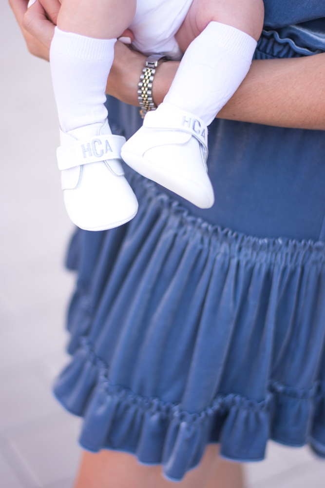 white monogrammed baby shoes