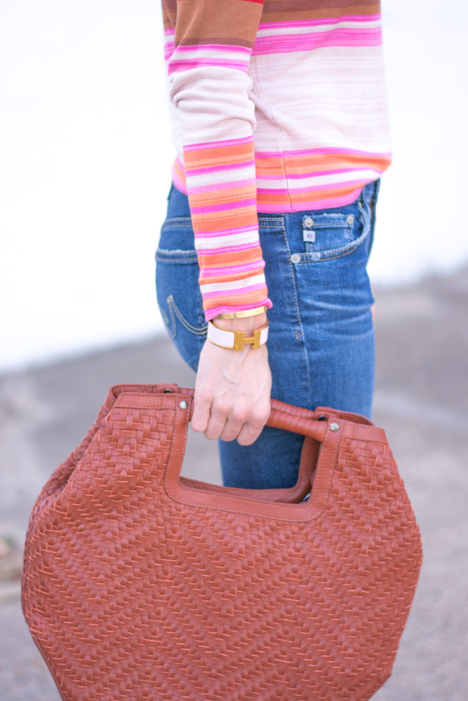 striped sweater jeans oversized brown handbag