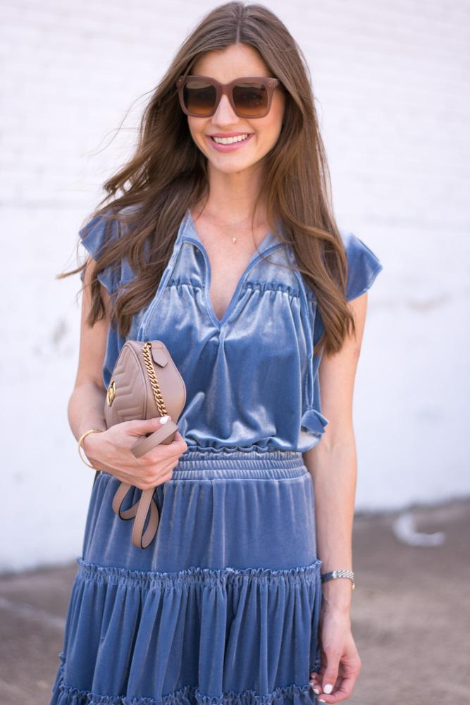 blue velvet dress nude handbag