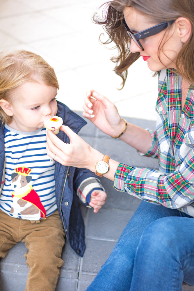 our favorite toddler outerwear sharing cupcakes outside