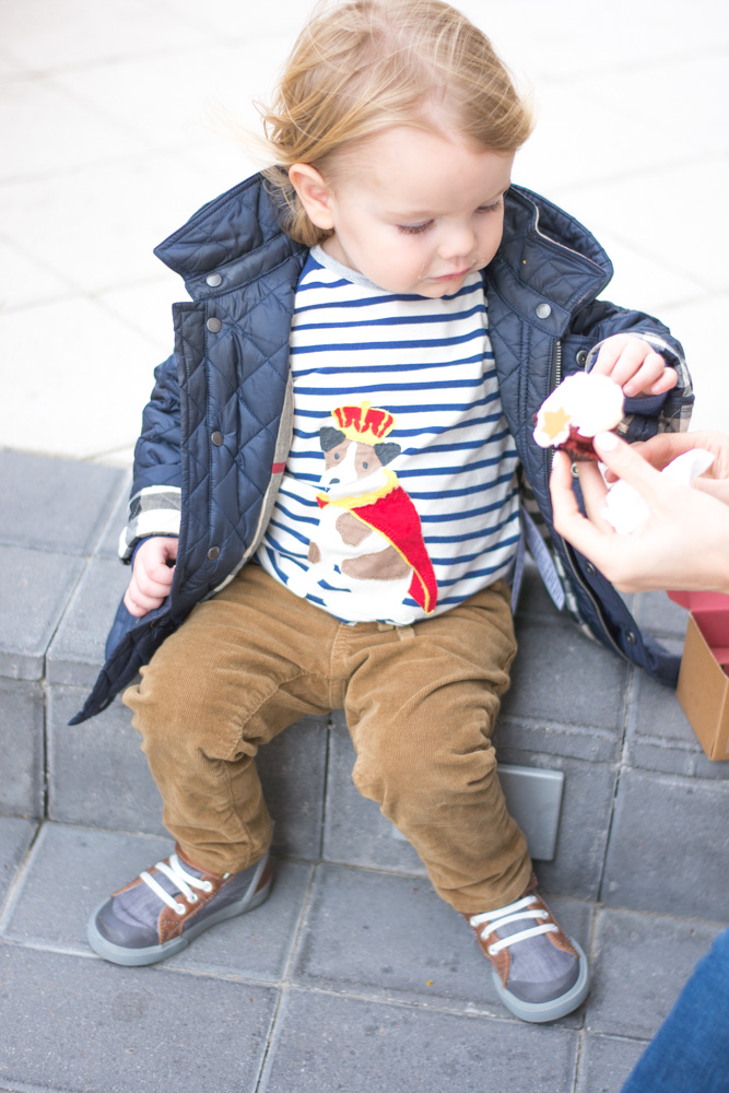 sharing a cupcake with a toddler outside