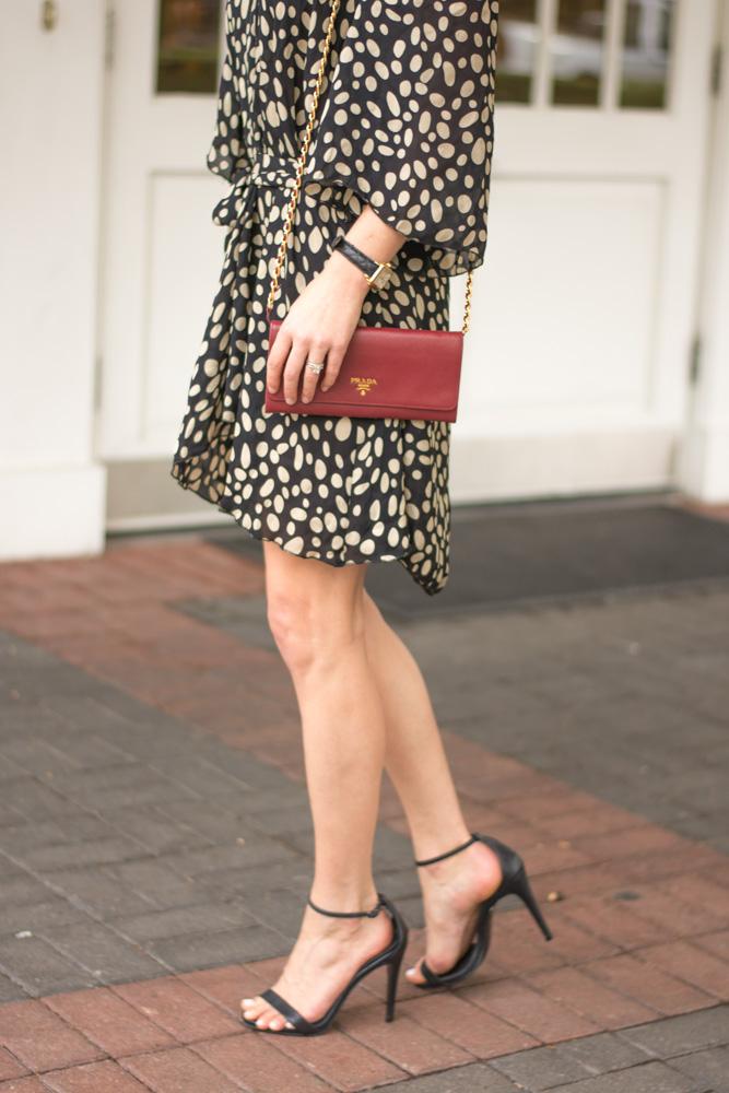 polka dot dress red clutch
