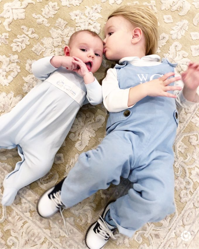 baby brothers in blue outfits