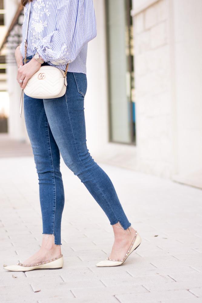 stagger hem jeans rockstud flats