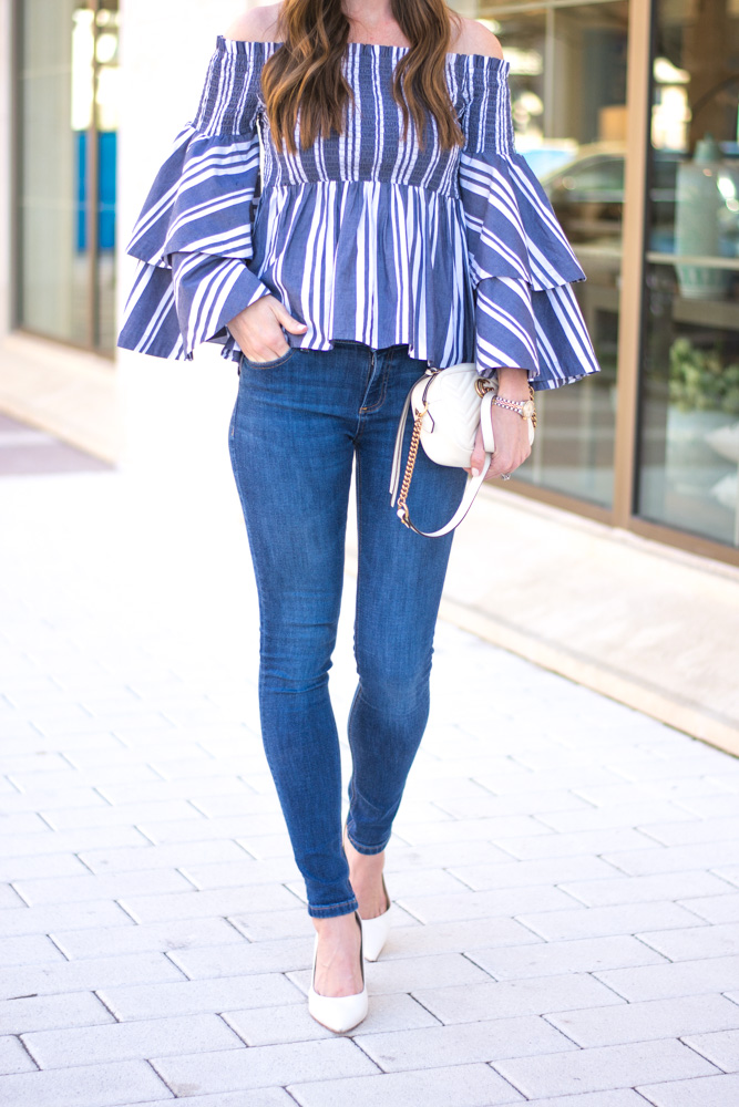 ruffle sleeve top white pumps white bag