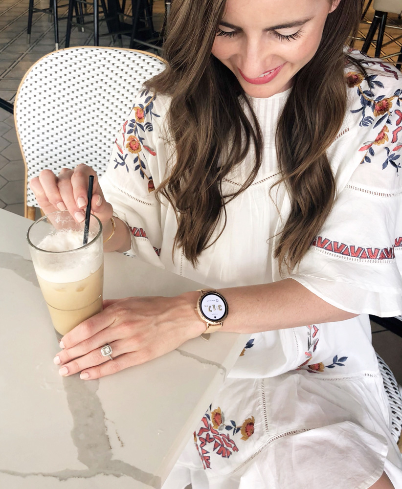 woman drinking iced coffee kate spade smartwatch