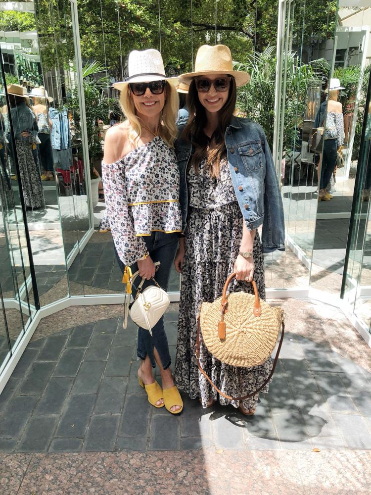 two women in straw fedoras