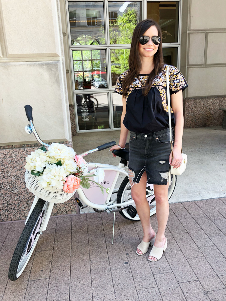 woman standing next to pink bike at the crescent hotel