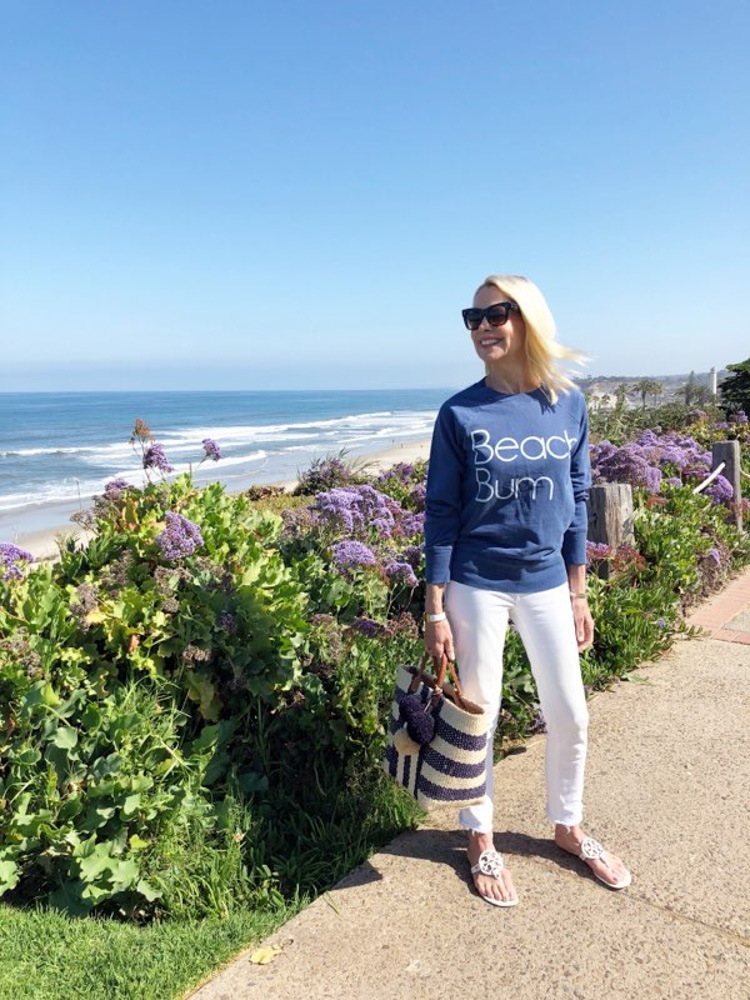 woman in beach bum sweatshirt at del mar