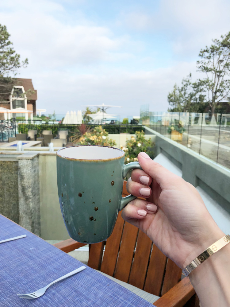 coffee overlooking pool and ocean in del mar