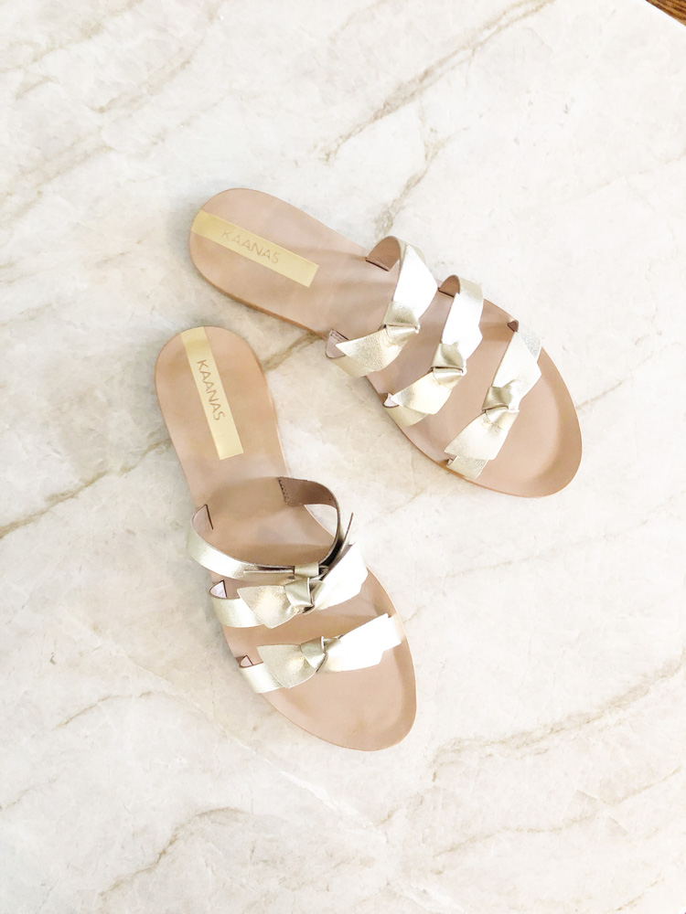 metallic gold sandals with bows