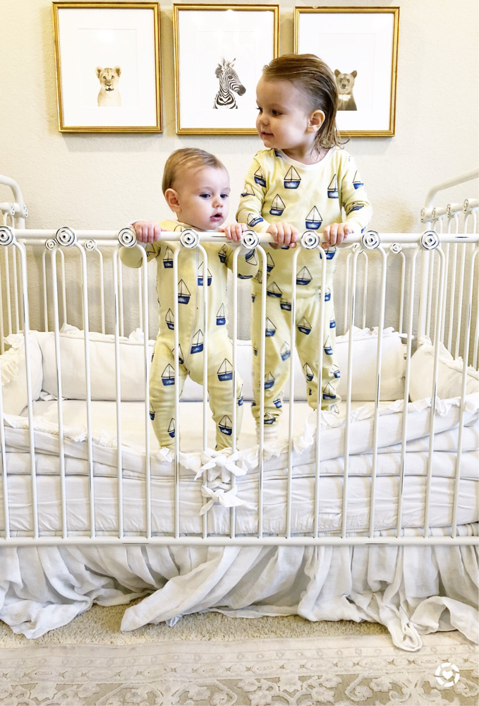 two baby boys in matching pajamas