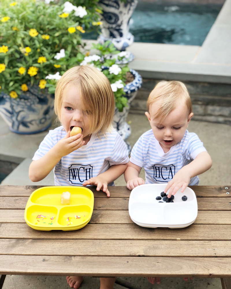 two boys eating at picnic table