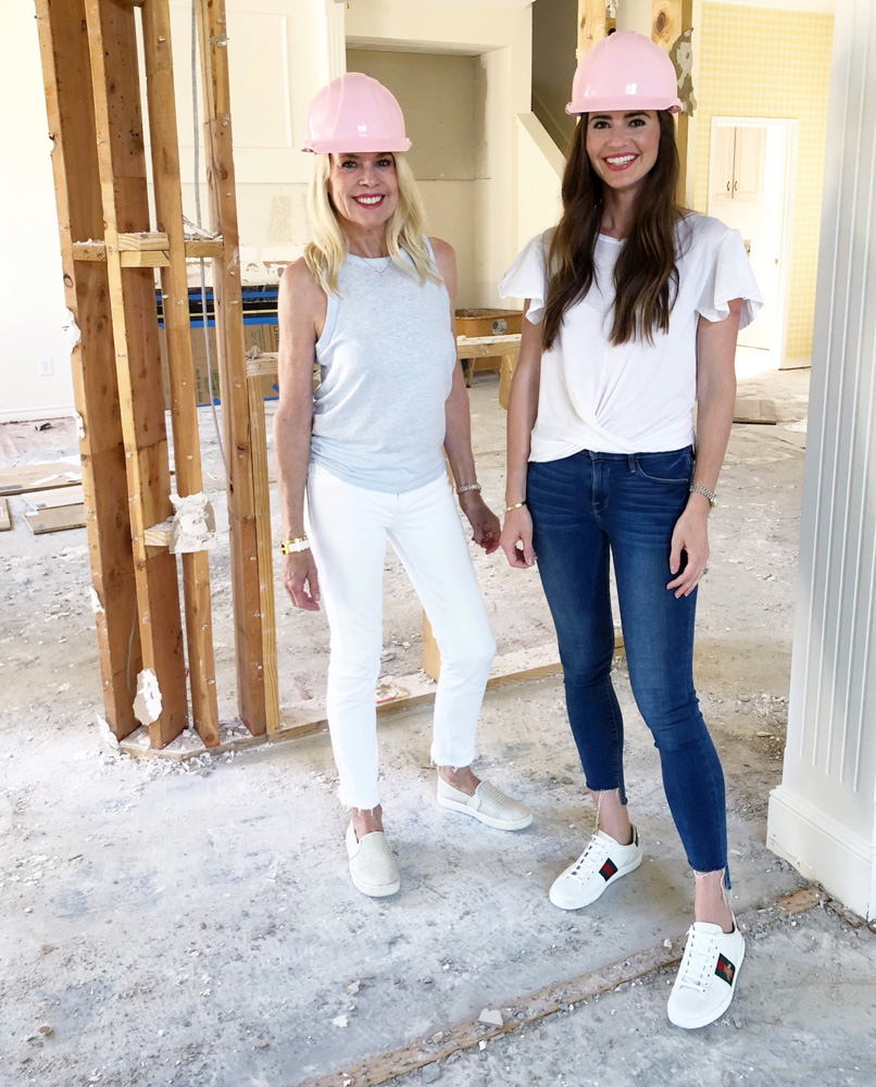two ladies in pink hard hats