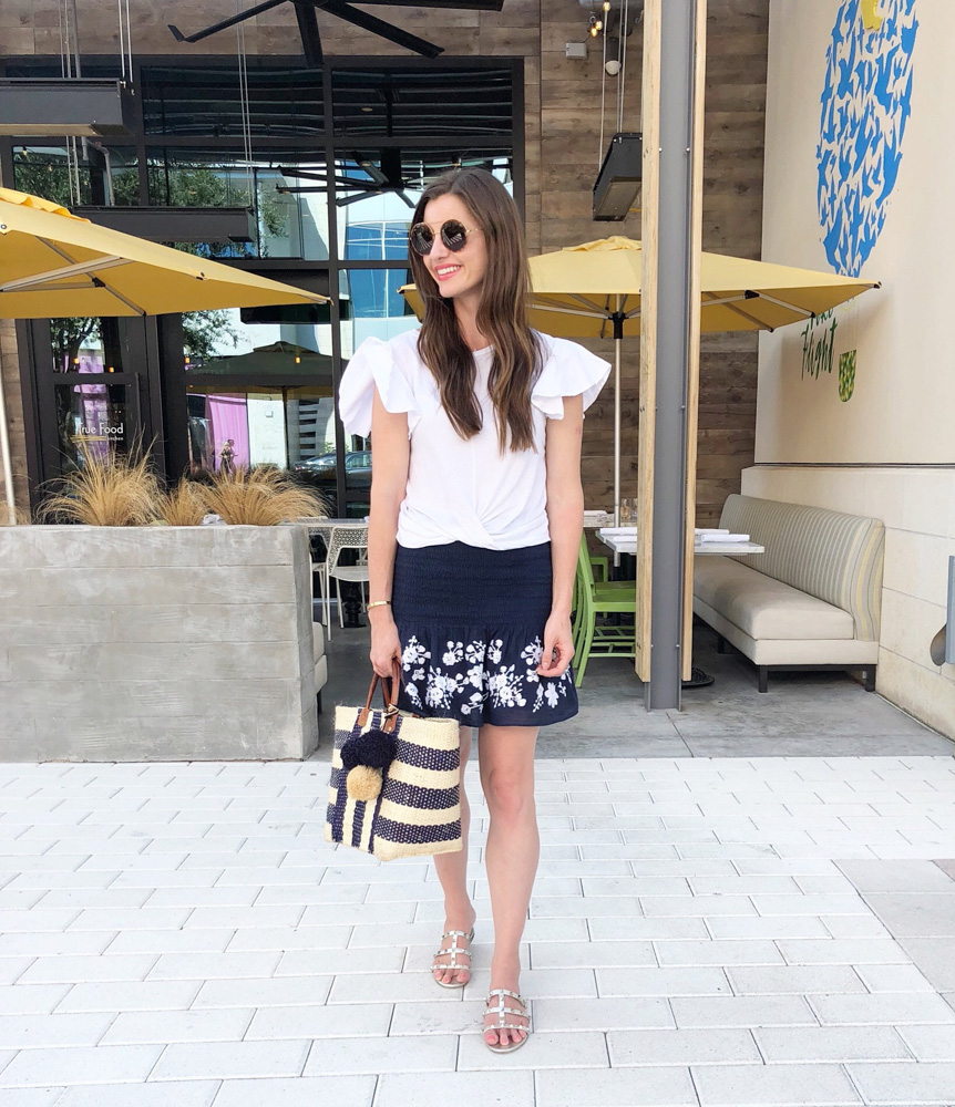 white top navy embroidered skirt