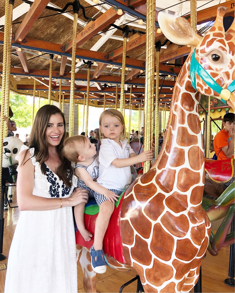 mom and toddler carousel ride