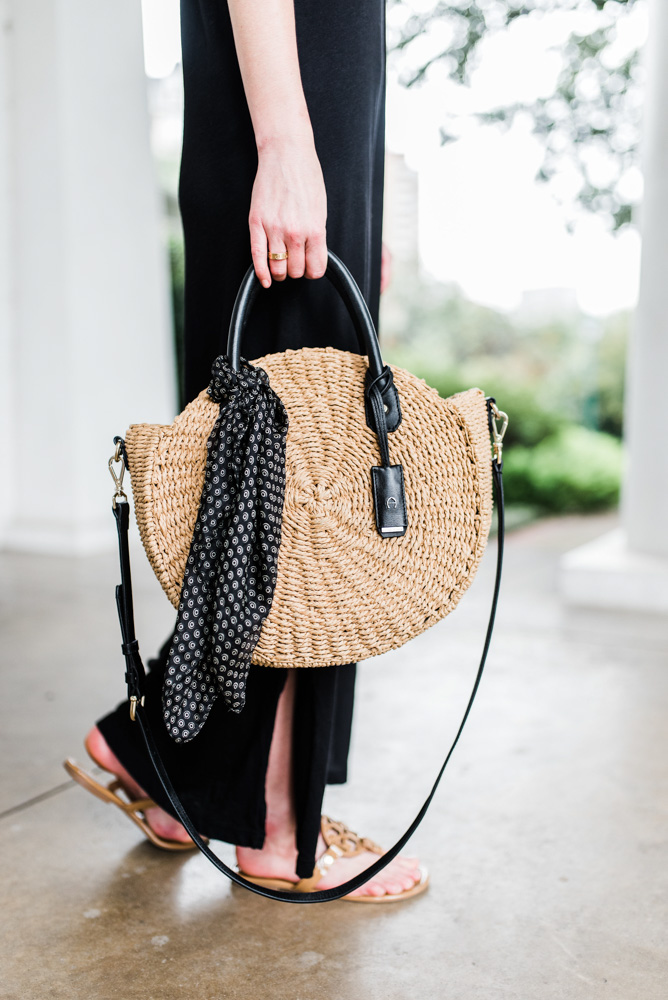 transitional black maxi dress straw bag