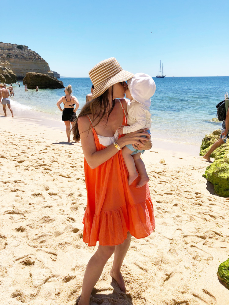 mom and baby visiting algarve beach