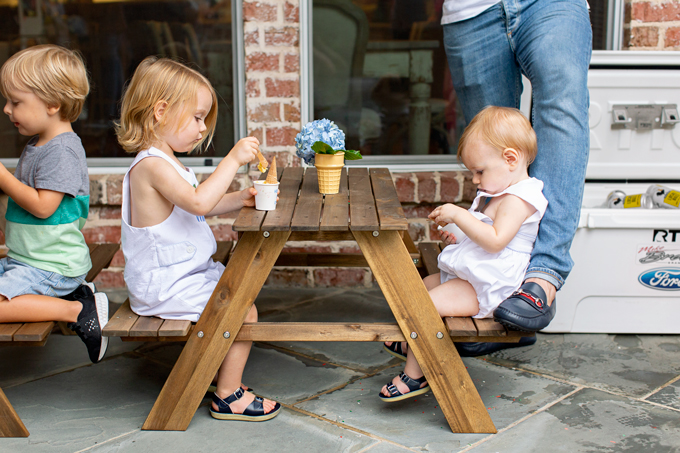 brothers eating ice cream at picnic table