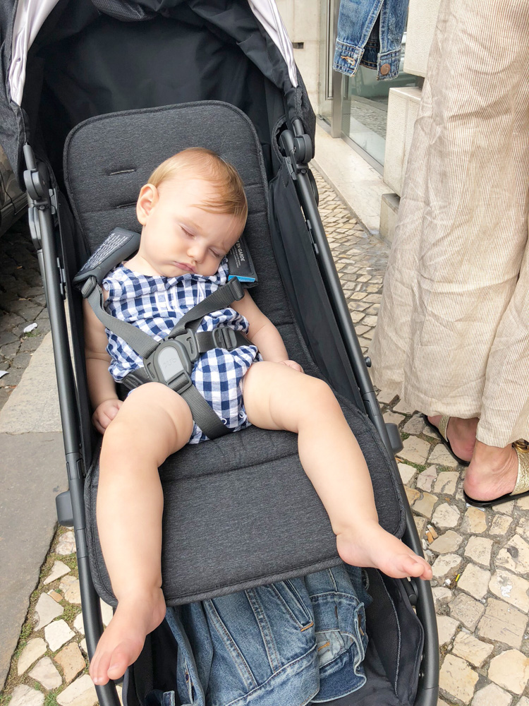 baby boy sleeping in stroller