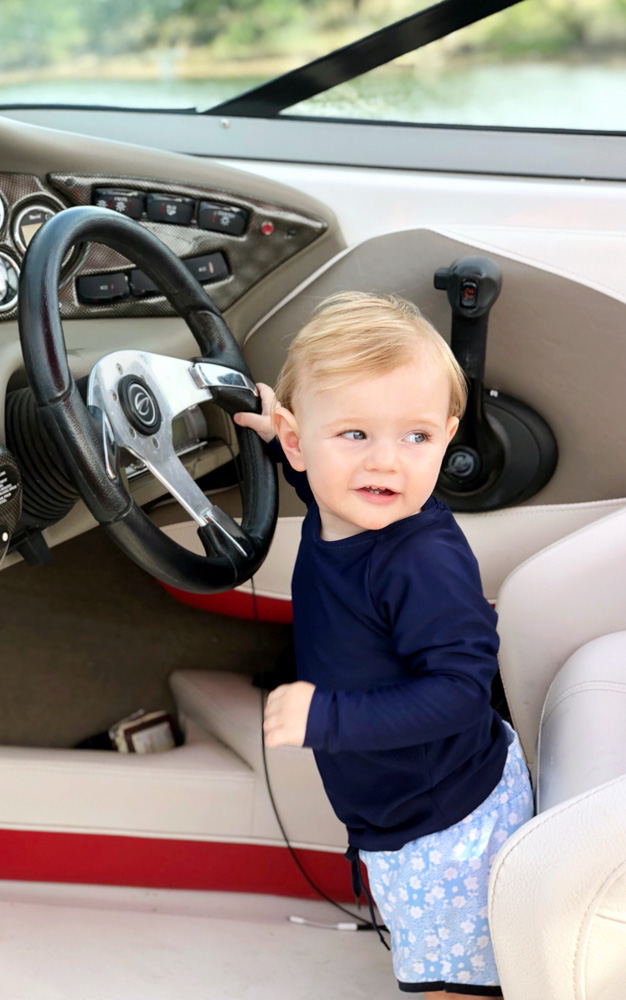 baby boy driving car