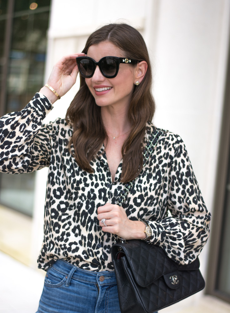 five leopard pieces we're loving leopard blouse black ssunglasses