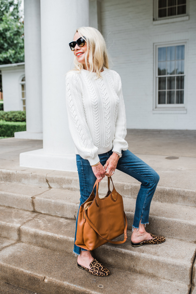 off white cable knit sweater jeans brown tote bag