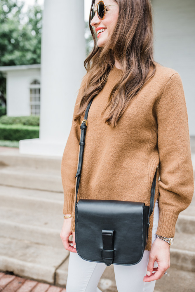 camel sweater black crossbody bag