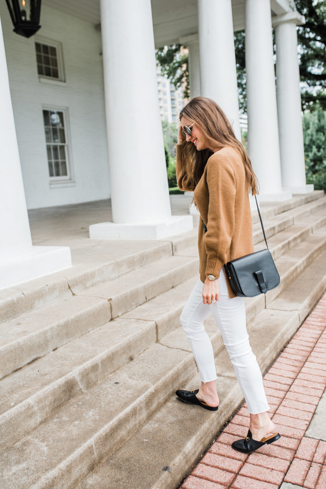 camel sweater white jeans black crossbody bag