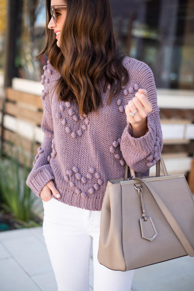 purple sweater tan handbag