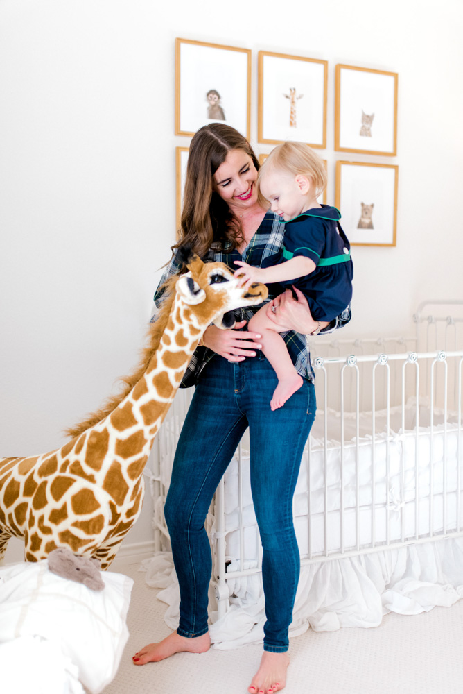 15 months with henry baby boy and mom with stuffed giraffe in nursery