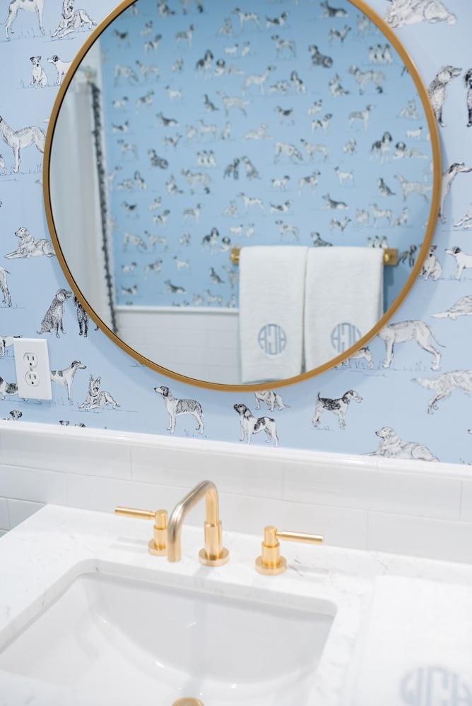 boys' bathroom details sink with round brass mirror
