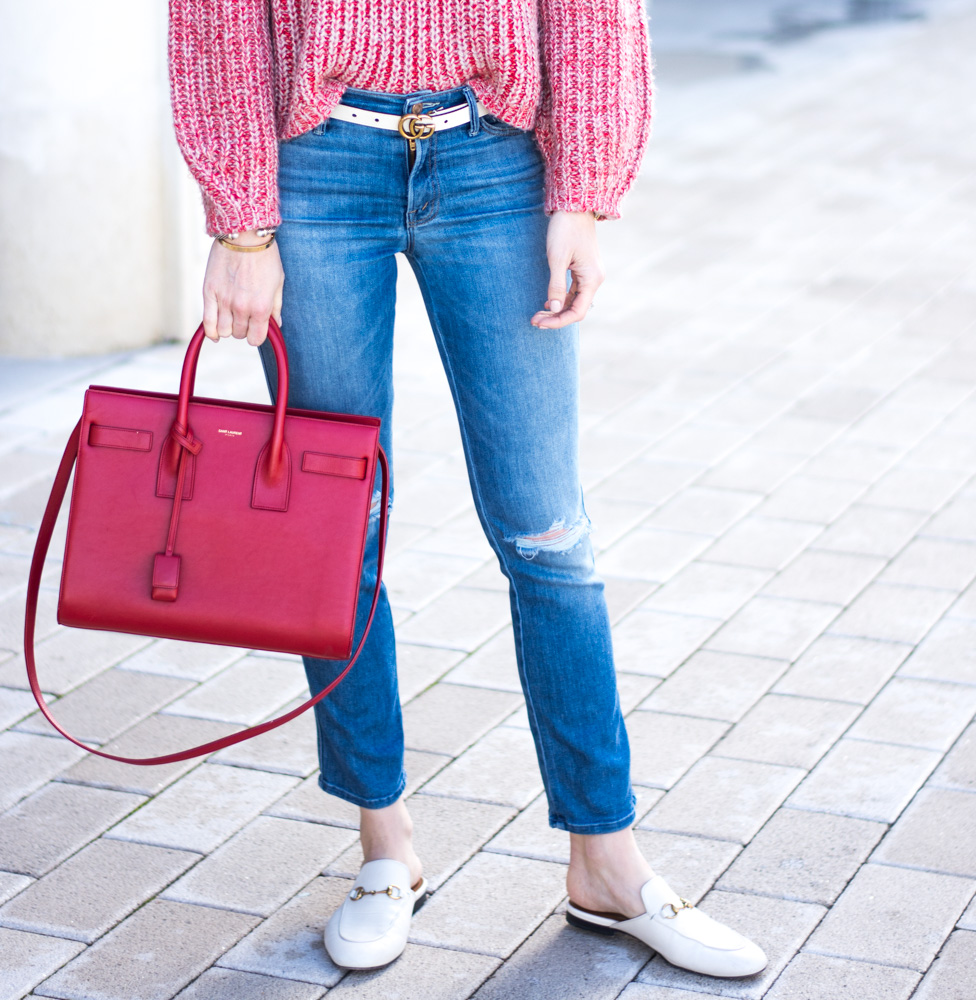 distressed jeans red handbag