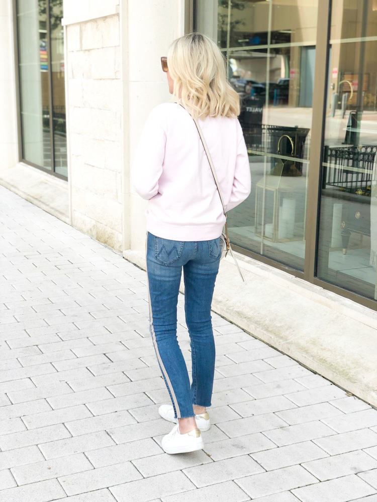 pink crew neck sweatshirt white sneakers