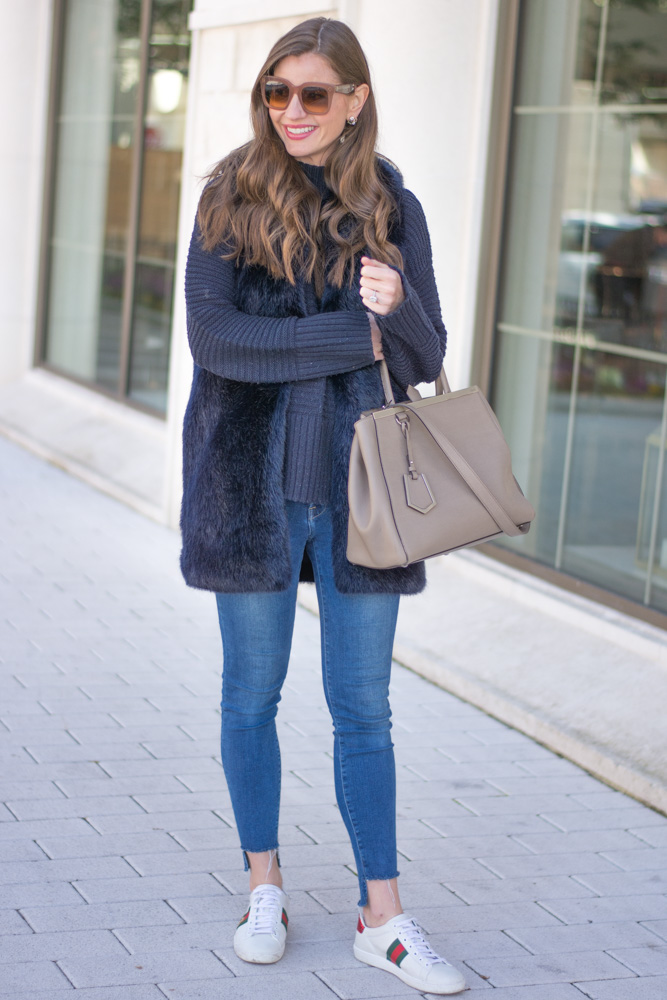 weekend casual faux fur vest jeans gucci sneakers
