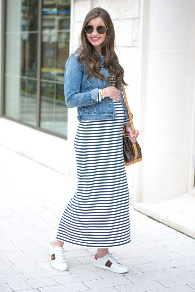 striped maxi dress denim jacket gucci bee sneakers louis vuitton bucket bag