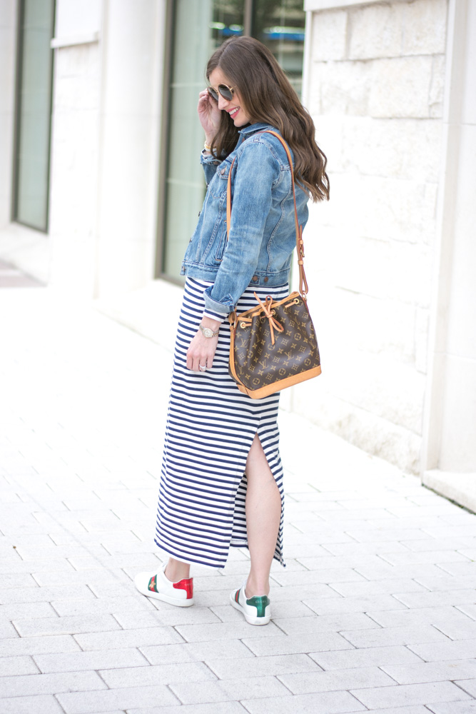 striped maxi dress louis vuitton bucket bag gucci sneakers