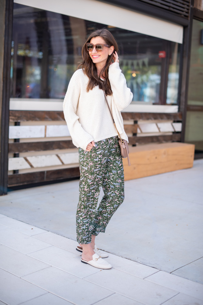 oversized white sweater printed silk pants white gucci loafer mules