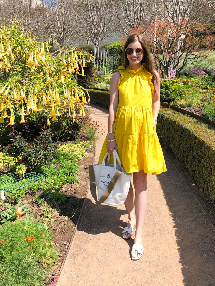 yellow tiered ruffle dress prada tote bag hermes sandals