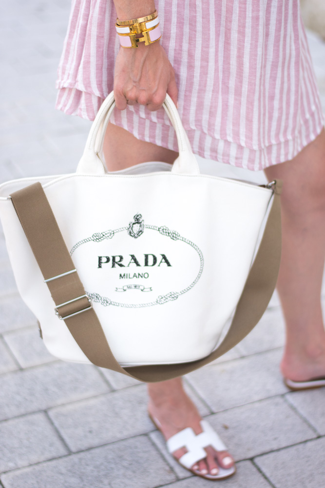 prada canvas tote bag white sandals pink striped dress