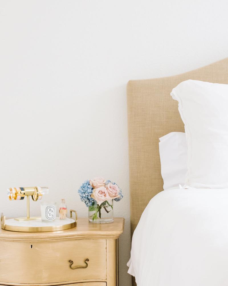 gold bedside table jewelry tray linen headboard