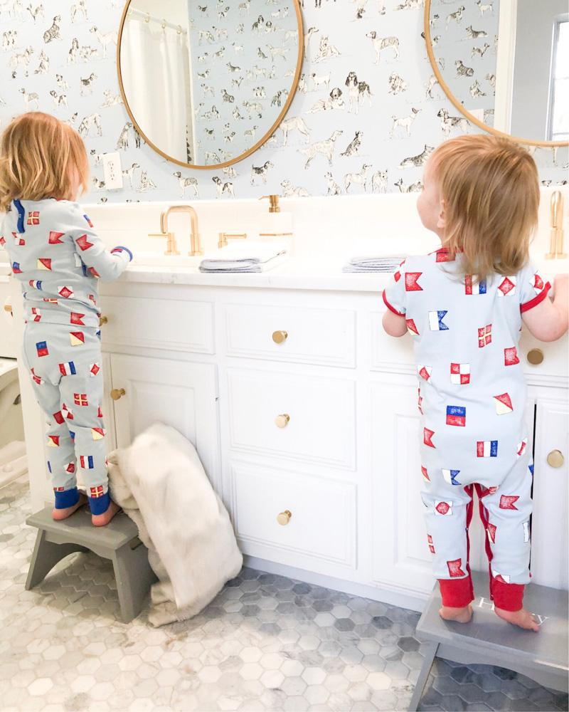 toddler boys brushing teeth at sinks wearing the beaufort bonnet company pajamas