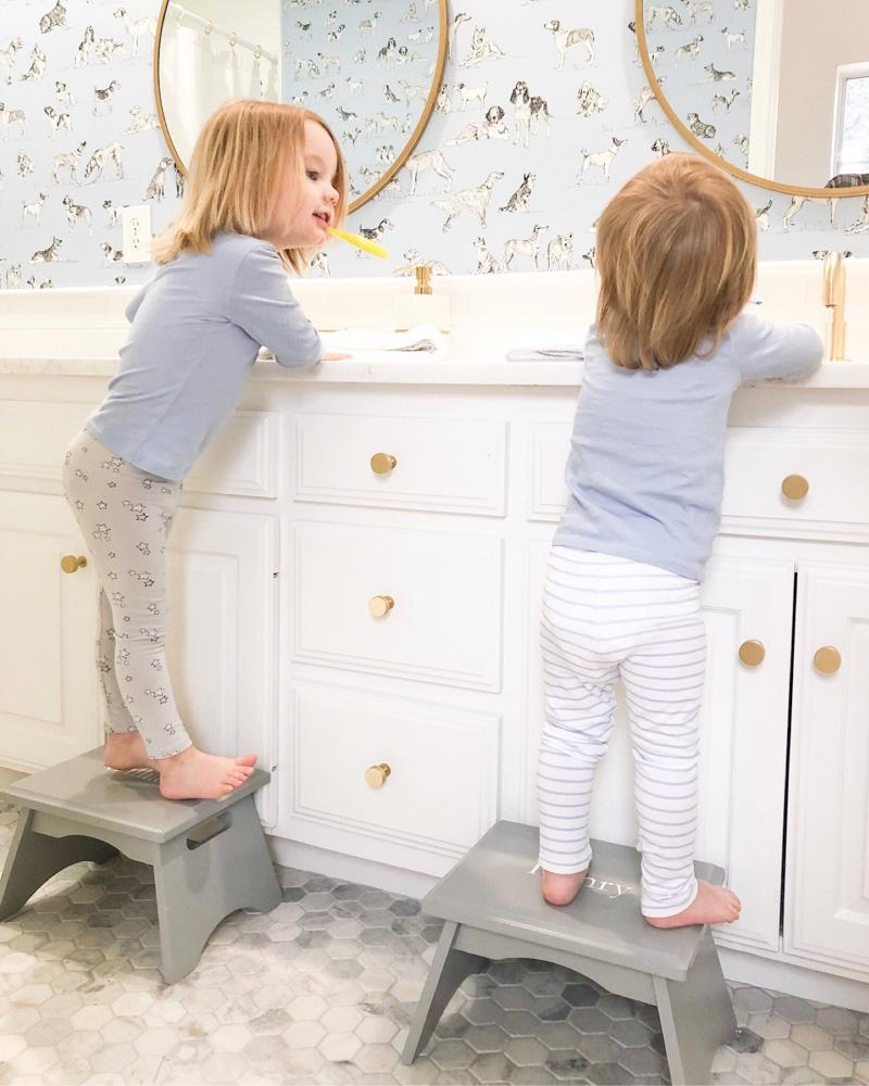 toddler boys brushing teeth at sinks