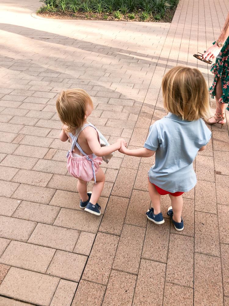 toddler boys holding hands