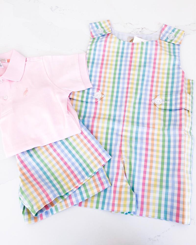 pink polo shirt plaid shorts plaid jon jon
