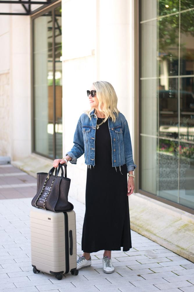 black maxi dress jean jacket chanel tote tan suitcase