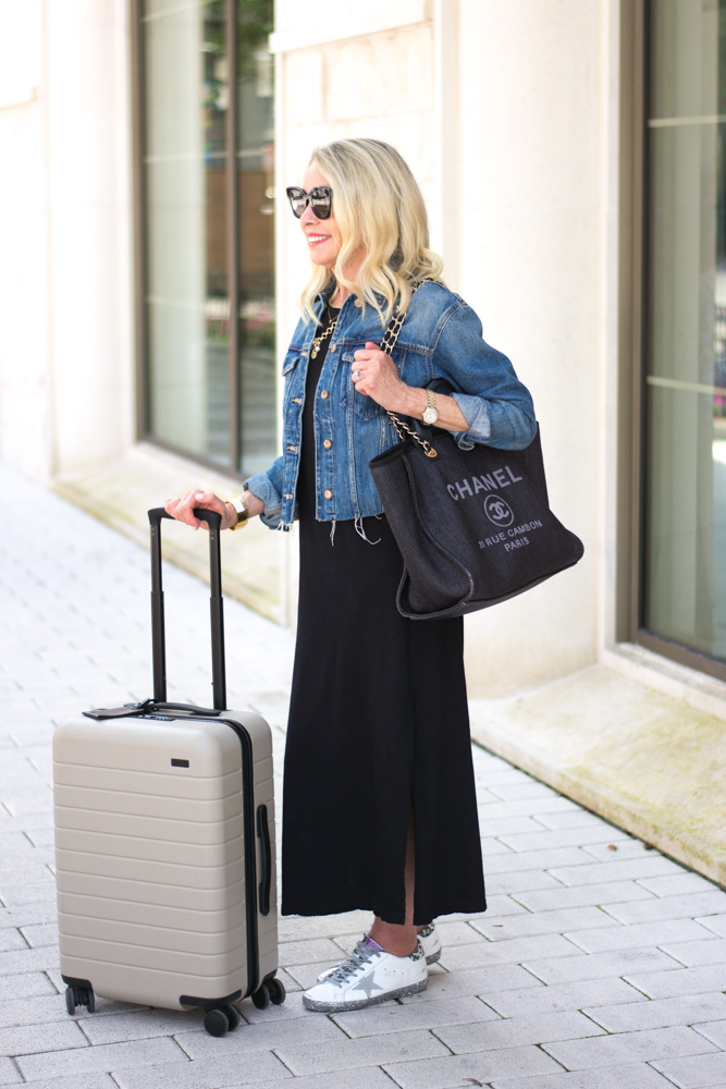 black maxi dress chanel tote bag jean jacket
